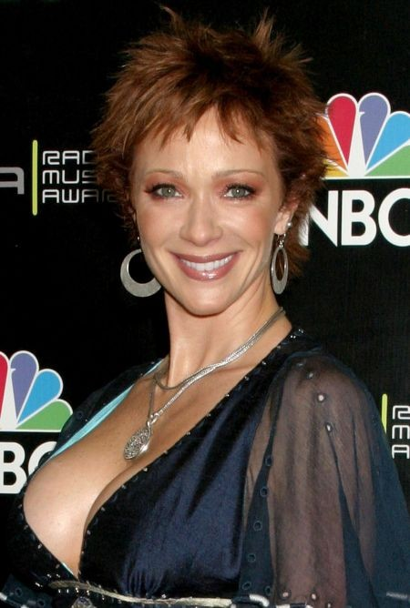Lauren Holly breast implants